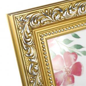 Багет золотой рамки с серебристым узором.